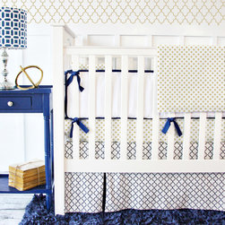 Caden Lane - Caden Lane Crib Bedding Set Golden Boy - A classic yet fresh design, the Golden Boy crib bedding set delivers preppy geometric, quatrefoil and solid fabrics to a baby's nursery. In navy blue and white with splashes of metallic gold, this two-piece collection features a fitted crib sheet and skirt with an optional square throw pillow, four-piece bumper, changing pad cover, two curtain panels, blanket and extra crib sheets. Receiving blanket and pillow monogramming are available. Made in the USA from 100% cotton. Blanket made from 50% cotton and 50% polyester. Machine washable.