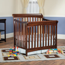 Child Craft - Child Craft Ashton Mini 4-in-1 Convertible Crib in Select Cherry - Gracefully contoured lines complement the classic sleigh style of this beautifully designed crib to make an elegant focal point of any nursery. The versatile design of this crib fits any decor.