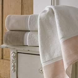 Frontgate - Porto Bath Towel - Choose from 3 colors: Blush, Linen, White. 100% organic cotton with linen end-hem. Sewn in hanger loop. 600 gsm. Machine wash cold, tumble dry low. Wrap yourself in the lavish yet eco-friendly Porto Towel Collection by Kassatex. Made of 100% certified organic cotton, each towel is accented with a unique patterned trim in a soothing color palette that promotes a tranquil and relaxing bathing experience. This sophisticated collection of soft towels combines casual living with modern luxury.  .  .  .  .  .