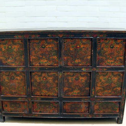 Large Living Room - This impressive vintage Tibetan chest is colorfully decorated to represent the exotic Tibetan culture and its expressive art style. The vibrant use of colors directly reflects the personality of Tibetan people who are passionate with life. The restoration to this Tibetan cabinet was purposely kept minimal to capture the original painting and color. Traditionally Tibetan cabinets were used for the storage of anything from foodstuffs to religious objects. Instead of swing on attached hinges, the doors pivot on round pegs. With two double door compartments, this rectangular cabinet provides ample of storage room and adds exotic to family rooms, dinning rooms, or bedrooms.