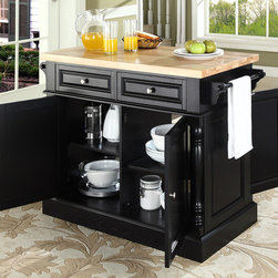 Crosley Furniture - Butcher Block Top Kitchen Island in Black Fin - Fully functional doors and drawers on both sides. Butcher block top. Two towel bars. Brushed nickel hardware. Carved column accents. Two adjustable shelves behind doors. Warranty: 90 days. Made from solid hardwood and wood veneers. 48.25 in. W x 23 in. D x 36 in. H (132 lbs.). Assembly instructionsThis kitchen island is designed for longevity. The handsome raised panel doors and drawer fronts provide the ultimate in style to dress up any culinary space. Great for food preparation, the butcher block top is a plus in any kitchen. Deep push-through drawers are great for holding essential items, such as utensils or storage containers. style, function, and quality make this kitchen island a wise addition to your home.