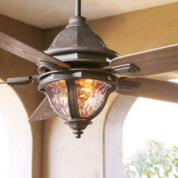 """Monticello"" Outdoor Fan - The ""Monticello"" Outdoor Fan is perfect for keeping you and your guests cool this summer during outdoor gatherings.  A warm walnut finish covers the motor housing.Includes a remote control. 52""Dia. x 21.25""T."