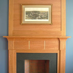 Flying Point Mantel - The extensive renovation of a Flying Point, Freeport home included a refit of the existing fireplace. Simple, geometric lines were chosen for the cherry mantel and overmantel. A honed slate hearth complements the mantel design.
