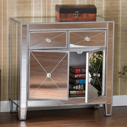 Holly & Martin - Holly & Martin Montrose Mirrored Cabinet - Painted silver wood trim. Mirrored finish. Drawers: 10 in. W x 10 in. D x 5 in. H. Cabinet: 27 in. W x 11 in. D x 12 in. H. Overall: 28 in. W x 13 in. D x 28 in. H (60.95 lbs.)Perfect for any room, this glamorous mirrored cabinet is a perfect compliment for your home. With its mirrored finish, it adapts to any surroundings without overpowering yet, catches your eye with its unique presence. The practical size and function works as well in the entryway, the living room or by the bedside. Finishing the piece off is a combination of two drawers and one large double door storage cabinet with faux crystal knobs.