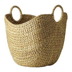 Large Curved Basket | West Elm - I love having some way to store my throws so that they are always in reach — this basket is a very good-looking option!