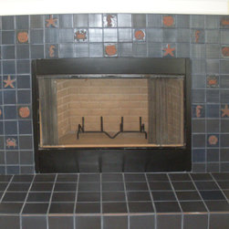 skelton fireplace.jpg - Beach house hearth on the Texas Gulf Coast.  All tiles are handmade, and accents are embossed with shell, sand dollar, crab, starfish, and seahorse designs.
