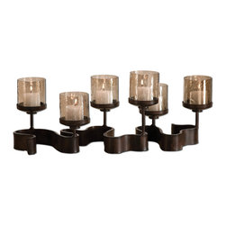 Uttermost - Ribbon Metal Candleholders - Grace your table with a swirl of light. This simply striking piece, a switch from the traditional candelabra, makes a statement with bronzed iron and copper-colored glass.
