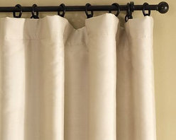 "Dupioni Silk Drape with Blackout Lining, 104 x 108"" Pole Pocket, Sahara - Only dupioni silk can deliver a look this rich. Its natural striations and slightly nubby texture are prized for their beauty. 50"" wide; available in five lengths. 104"" wide; available in four lengths. Threads of natural silk vary in thickness, producing beautiful texture and depth. Woven of pre-dyed yarns for color retention and quality over many years. Includes a blackout liner for minimal light filtration. Detailed with a blind-stitch hem. Hangs from the pole pocket or converts to ring-top style with the included drapery hooks. Use with 7 Clip or Round Rings for the single-width and 13 for the double-width (sold separately). Watch a video about the story behind our {{link path='/stylehouse/videos/videos/pbq_v19_rel.html?cm_sp=Video_PIP-_-PBQUALITY-_-SILK_DUPIONI_WINDOW' class='popup' width='950' height='300'}}Silk Dupioni window treatments{{/link}}. Watch a video on {{link path='/stylehouse/videos/videos/h2_v1_rel.html?cm_sp=Video_PIP-_-PBQUALITY-_-HANG_DRAPE' class='popup' width='420' height='300'}}how to hang a drape{{/link}}. Select items are Catalog / Internet Only. Imported."