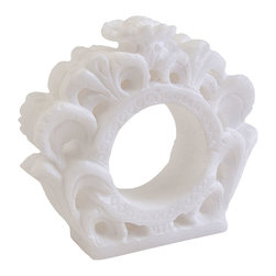 Ornate Frame Napkin Ring - White is not the absence of color; it is the presence of perfection. The Ornate Frame Napkin Ring boasts an asymmetrical intricate looped pattern that imparts a distinctive loveliness to your table. Whether placed amidst an all-white tablescape or one of bold hues, the napkin ring is certain to catch the eye of your discerning guests.