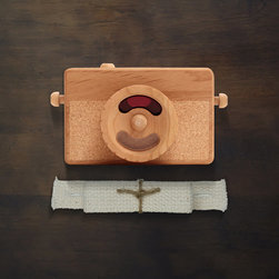 Instamatic Wooden Toy Camera by Twig Creative - I love items that serve dual purposes. This camera will be a great toy as your little one gets a bit bigger, and it looks great in the space as well. Win-win.