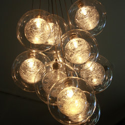 Kadur - These perfectly sphere shapes have all the elegance and sophistication while evoking whimsical floating bubbles.