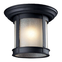 One Light Black Clear Seedy Glass Outdoor Flush Mount - This cast aluminum outdoor flush mount uses seedy frosted glass to create a unique look, along with the black finish.