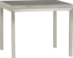 "Concrete Top/ Stainless Steel Base 36"" Sq. Parsons Dining Table - Start with a great base. Top it off with an eye-catching top. Voila—the perfect table. Stainless-steel frame with a contemporary matte finish supports with clean simple lines. Gorgeous warm grey concrete top mixes up a global compound sourced in Vietnam—marble, stone and granite from the mountainous Dalat region and grassy fibers from the Mekong Delta for added strength. Clean and modern material is also eco-friendly, handmade in shops powered without fossil fuels. Due to the handmade nature of the concrete mix, color will vary and may change over time. Seats four."