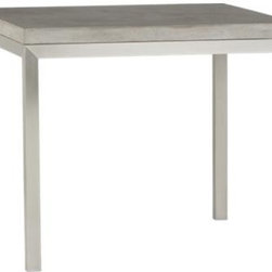 """Concrete Top/ Stainless Steel Base 36"""" Sq. Parsons Dining Table - Start with a great base. Top it off with an eye-catching top. Voila—the perfect table. Stainless-steel frame with a contemporary matte finish supports with clean simple lines. Gorgeous warm grey concrete top mixes up a global compound sourced in Vietnam—marble, stone and granite from the mountainous Dalat region and grassy fibers from the Mekong Delta for added strength. Clean and modern material is also eco-friendly, handmade in shops powered without fossil fuels. Due to the handmade nature of the concrete mix, color will vary and may change over time. Seats four."""