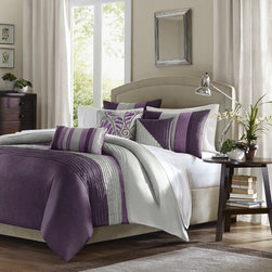 "Madison Park - Amherst Duvet Set - Amherst is a perfect way to add a splash of color and to give your bedroom a fresh update. The violet and plum colors are paired back with a silver grey color and add a pop color to your room; neutral colors of ivory, pearl and taupe are pieced together to create this beautiful duvet. The filled piping details that run horizontally across the duvet and vertically on the shams add texture and dimension to this very simple and clean duvet. Features: -Set includes 1 duvet, 2 standard shams and 3 decorative pillows. -Pieced polyester dupioni. -Pieced and embroidered decorative pillows. -Pleated duvet and shams. -Dimensions: 90""-104"" Height x 90""-92"" Width."