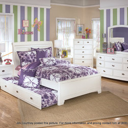"""Ashley Furniture - Home Design Network - HDN recommends Ashley Products. The light airy cottage design of the """"Lulu"""" youth bedroom collection features a replicated white paint finish flowing beautifully over the grooved panels and embossed bead framing to make this innovative furniture an inviting addition to any child's bedroom. Series Features: Replicated white paint. Grooved panels and embossed bead framing drawers. Rolling trundle storage box enables the option of storage or bed. Space saving corner media unit with desk function and upholstered storage stool. Side roller glides for smooth operating drawers. or more information please contact Jim Courtney at (808) 375-4759 or email at jcourtney@ashleyhawaii.com"""