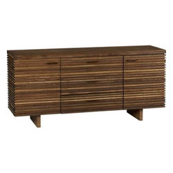 Paloma II Large Sideboard - A modern piece with a rich history, the Paloma sideboard is the story of timber reclamation from around the world. Paloma's distinctive door fronts feature dynamic stacking of precision-cut strips of peroba wood reclaimed from Brazilian homes no longer in use. In organic contrast is a solid slab top of ironbark hardwood, recouped from Brisbane's historic Hornibrook Highway Bridge, demolished by the Australian government in 2011. This artful Zen-meets-Prairie Style dining collection displays the beautiful range of dark and honeyed browns and natural graining to be found in these repurposed woods.A special joinery technique creates a smooth, flush transition between top and base. Three center drawers pull out on metal glides to store linens and silverware; flanking cabinet doors open to a total of four adjustable shelves for china and serving pieces.