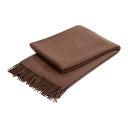 Christy - Christy of England Jura Throw - Mink - 120001379634816180 - Shop for Throws from Hayneedle.com! The Christy of England Jura Throw - Mink is wonderful for adding a soft decorative layer to your bed or better yet wrapping yourself in warmth for a little cozy comfort during the winter months. This dark brown throw is handmade from pure Scottish lamb's wool and gentle angora for an absolutely luxurious look and feel. The throw is machine washable but wash deep colors separately. Using detergents containing brighteners will affect the throw's shade. Measures 51 x 71 in.About Christy LifestyleAmazing how something so soft could have such an incredible impact on the world. In 1850 Henry Christy procured a small sample of looped pile fabric unseen in the Western World. He and his brother Richard Christy were taken with the delicate feel and incredible absorbency of the material and soon learned ways of reproducing the loop pile mechanically. The mass-produced terrycloth was an instant sensation that even Queen Victoria ordered in abundance. One hundred sixty-five years later the Christy name is still at the height of luxury home interiors and stands as England's premier retailer of everything from exquisite homewares to famous Egyptian cotton towels. Christy has even become the official towel supplier of Wimbledon.