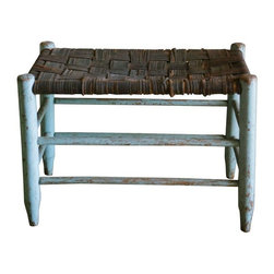 Used Distressed Wood and Leather Stool - The perfect rustic stool! A distressed French blue painted stool dressed with a leather basket weave top. The paint is distressed and off in some places. The leather is loose in some places on the top. We can see this in so many places - by chair, with books and magazines on top or in a bathroom by the tub to place your towel.