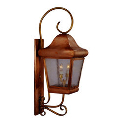 Belmont Copper Lantern Wall Light with Bracket and Scroll - The Belmont Wall Mount Copper Lantern with Bracket and Scroll, shown in Raw Copper with Seedy Glass, is made in America from high quality copper or brass and is designed to last for decades. This Colonial style wall mount lantern comes in three standard sizes with your choice of seven all-natural hand applied finishes and four unique style of glass at no extra cost. Available as wall mounted copper lantern with bracket and scroll, a post mounted copper lantern and a pier-base column mounted copper lantern in a variety of size, finish and glass options, this classic Colonial lantern works well with Colonial, Colonial Revival, Spanish Colonial and English styles homes, lakes homes and cabins.