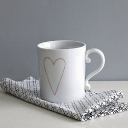 Heart Mug - Sipping a hot cup of joe out of this pretty little mug will make you forget your winter blues in a flash.