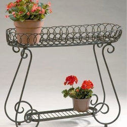 Deer Park Ironworks Oval Ring Planter - Give your pampered plants and fabulous flowers a special stage on which to shine with the Deer Park Ironworks Oval Ring Planter. Our decorative planter is made of a heavy gauge steel and finished with a baked-on natural patina powder-coat. It holds four, 8-inch pots of your favorite foliage and has rubber feet for protection. It's an elegant way to display plants, and it blends nicely with any decor or color scheme.About Deer Park Ironworks Deer Park Ironworks has a reputation as a premier wrought iron lawn and garden company. They create timeless designs with quality materials and price them at competitive rates. All of their products are made from heavy gauge steel and have a durable powder-coated finish, which are Earth-friendly since they emit zero, or near zero, volatile organic compounds. Deer Park's powder-coating finishes also produce a much thicker coating than conventional liquid coatings that sometimes run or sag. Furthermore, Deer Park's products feature a unique natural patina appearance that complements any decor or color scheme. And their decorative baskets, wall planters, and window boxes come with a fitted coco liner that is a natural product that helps with proper drainage and provides a healthy environment for your plants to grow.