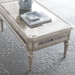 Horchow - Dresden Mirrored Coffee Table - Allover shine marks this coffee table as one you'll find a versatile fit with a variety of decorating styles. Imported. Coffee table is made of select hardwoods in an antique-cream finish with silvery accents. Antiqued mirrored glass panels all around...