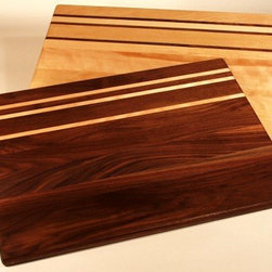 Countertop Board - A countertop board like this one will add an old-world feel to any kitchen. The contrasting dark and light wood tones make it a work of art.