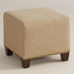 """World Market - Linen McKenzie Ottoman - Boasting a classic design with nail head trim, our custom-made Linen McKenzie Ottoman is handcrafted in the U.S.A. with crisp linen upholstery. Pair two ottomans for a dramatic """"bench"""" at the foot of the bed. Shop our coordinating bed or headboard in the same custom fabric for a pulled together look."""