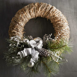 "Horchow - Decorated Christmas Wreath - Exclusively ours. We love the natural ambiance that emanates from this wreath with durable faux bristle pine, plastic silver ornament balls, and a sheer ribbon. Hang in a special space to greet guests. Handcrafted. 31""Dia. x 8""D. Imported."