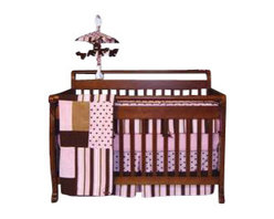 Trend Lab - Pink Maya Crib Bedding Set (4-Piece) - Maya combines traditional polka dots and stripes in a simply modern color combination of pink with chocolate and caramel browns. The group includes super soft ultra-suede, velour and linen accents. The Pink Maya baby Girl crib bedding 6-Piece set by trend Lab includes a crib quilt, crib bumpers, crib sheet, crib skirt and 2 picture frames.