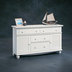 "Sauder - Harbor View 4 Drawer Dresser - This dresser has a perfect easy-living cottage look and is an eclectic piece of graceful yet simple detailing that is highlighted by an antiqued paint finish. Features: -Four drawers with metal runners and safety stops.-Additional storage behind detailed cabinets.-Solid Wood Construction: No.-Powder Coated Finish: No.-Gloss Finish: No.-Non Toxic: Yes.-Scratch Resistant: No.-Storage Function: Clothing.-Drawers Included: Yes -Number of Drawers: 4.-Drawer Interior Finish: Wood.-Drawer Glide Material: Metal.-Soft Close or Self Close Drawer Glides: Yes.-Safety Stop: Yes.-Ball Bearing Glides: Yes.-Joinery Type: Twist lock.-Drawer Dividers: No.-Felt Lined Drawers: No.-Drawer Handle Design: Knob..-Clothing Hooks Included: No.-Clothing Rod Included: No.-Foot Design: Bun.-Cabinets Included: Yes -Number of Cabinets: 2.-Adjustable Interior Shelves: No.-Number of Doors: 2..-Hidden Storage: No.-Interchangeable Panels: No.-Mirror Included: No.-Hutch Included: No.-Finished Back: No.-Distressed: Yes.-Collection: Harbor View.-Swatch Available: Yes.-Commercial Use: No.-Country of Manufacture: United States.-Eco-Friendly: Yes.-Product Care: Damp Cloth.Specifications: -FSC Certified: Yes.-EPP Compliant: Yes.-CPSIA or CPSC Compliant: Yes.-CARB Compliant: Yes.-JPMA Certified: No.-ASTM Certified: Yes.-ISTA 3A Certified: Yes.-PEFC Certified: Yes.-General Conformity Certificate: Yes.-Green Guard Certified: No.Dimensions: -Overall Height - Top to Bottom: 33.75"".-Overall Width - Side to Side: 58.25"".-Overall Depth - Front to Back: 17.625"".-Overall Product Weight: 149 lbs.Assembly: -Assembly Required: Yes.-Tools Needed: Hammer and phillip's screwdriver.-Additional Parts Required: No.Warranty: -Product Warranty: 5 years."