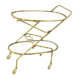 Vintage French Brass Bamboo Style Bar Cart - A great looking French brass and glass bar cart, with loops to hold bottles in place. The brass has a nice aged patina. There are some scratches on the glass. The wheels move fine. The top shelf is 27 inches off the floor, a good height for a side table!     Pull your bar together in style!