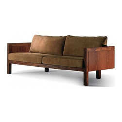 São Conrado Designed by Claudia Moreira Salles - The thing that probably catches your eye first with this slightly blocky sofa is the fact that the front and back legs are not aligned - usually a sofa like this would be perched atop big blocky legs, or the solid wood would extend all the way to the floor. This lighter iteration gives the chi more room to flow through your room.