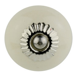 Knob Lovers - Anya Knob - Meet Anya a white ceramic knob with classic beauty. She is set upon a silver mount and topped with a silver cap. All of Knob Lovers' knobs are perfectly suited for anything from side tables and chests to kitchen and bathroom cabinets looking for a bit of flair.