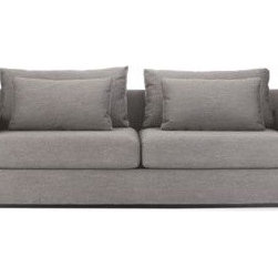 Design Within Reach - Simpatico Sofa - The handcrafted Simpatico Collection (2010) delivers comfort and elegance in one exquisite package. Wonderfully simple and with barely a seam in sight, there's a gracefulness to the shape of these pieces. Upholstered with what's called waterfall tailoring, the cushions and frames are sewn with one continuous piece of fabric wrapping over the front, from top to bottom or side to side. The cushions are finished with a boxing strip around the sides and constructed without welting or visible stitches. It takes expertise and careful planning to upholster this way, but before you think Simpatico sounds too precious for everyday living, think again. Deep seats, wide armrests (a magnificent perch for your laptop) and down-blend throw pillows make Simpatico a great place to hang out. Adjust the back cushions to find your perfect seat depth or stretch out for a comfortable nap.†