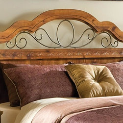 Standard Furniture - Hester Heights Panel Headboard - The beautiful color and ornamental iron work gives the collection style and movement. French dovetail construction. Surfaces clean easily with a soft cloth. Made from wood products with simulated wood grain laminates. Group may contain some plastic parts. Dark old fashion wood finish. 63 in. W x 2 in. D x 55 in. HHester Heights features simple style and appealing design making it the perfect addition to today's home.