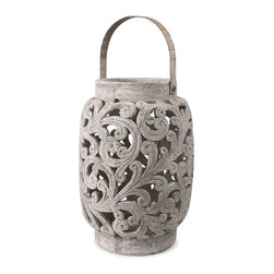 Darby Oversized Cutwork Lantern - The Darby oversized cutwork lantern has a vintage finish and looks great with a variety of decor. Holds pillar candles.