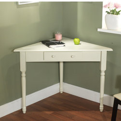 None - White Corner Desk with Turned Legs - This corner desk is the perfect addition to a home office, child's study area or dorm room. The engineered wood features a classic white finish suitable for any corner.