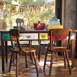 Brunswick Play Table & Hudson Vintage Chairs - Zone three is an art station. A table in the middle of the room will allow kids to gather round to work on projects together and then play games when they're done creating. This table does an impressive job of juxtaposing vibrant colors with a vintage feel.