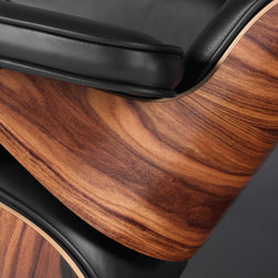 Eames Style Lounge Chair - A Closer Look - Our Plywood Lounge Chair seat cushions are perfectly contoured. The pitch is a 15% recline and the high back provides the utmost in comfortable seating. Our signature replica of the original Plywood Lounge Chair comes complete with all the original features. From the leather and die cast aluminum base to the Kiln Dried Polyurethane real wooden shell, no detail has been overlooked. You can purchase your very own piece of history, made by hand using the highest quality materials in a variety of finishes.