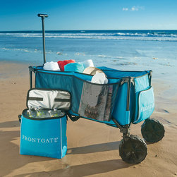 "Frontgate - Foldable Beach Wagon - Durable, powdercoated steel frame with heavy-gauge nylon fabric. Front bottle holders. Side mesh pocket provides additional storage. Folds to a mere 12"" sq. x 34""H. 100 lb. carrying capacity. This rugged wagon replaces numerous trips hauling gear, and then folds compactly to store in a car or closet. Outfitted with heavy-duty wheels, it's perfect for maneuvering over sand, down the boat dock, or across fields to a soccer tournament.  .  .  .  .  . Rugged 10"" dia. plastic wheel . Includes an insulated, removable cooler . Storage bag protects wagon during storage ."