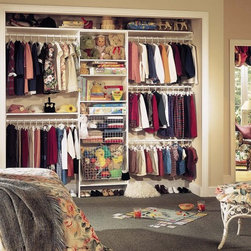 Reach-In Closets - Reach-in closet with wire baskets and multiple hanging rods.