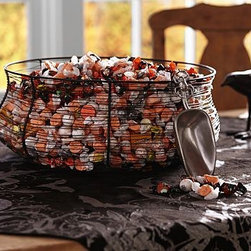 """Wire Spiderweb Candy Bowl with Scoop - Make it easy - and a little creepy - for guests to serve themselves as much candy as they like from our spider web bowl. 9.5"""" diameter, 8"""" high Bowl is made of handwoven iron. Scoop made of cast aluminum with a nickel finish. Set includes bowl and scoop. Catalog / Internet only."""