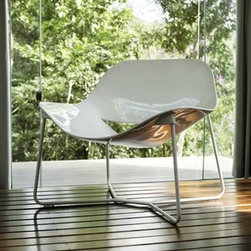 Modloft - Modloft | Oakley Lounge Chair - Made in Brazil by Modloft.The Oakley Lounge Chair features a smooth plane of molded seating with rear cut-out detail. Offered with a stainless steel frame with matching lacquer seating. Available in a variety of paint and lacquer finish options.