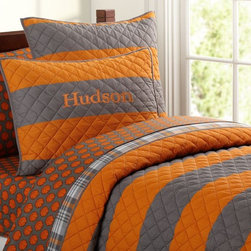 Rugby Stripe Quilt - I really like the bold gray and orange color combination in this quilted blanket. It's perfect for a teen's bedroom.