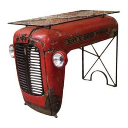 Pre-owned Upcycled Vintage Tractor Table - This abandoned tractor was rescued from an empty field and given new life in the form of an upcycled writing table. Curated by a creative thinker who sees treasures where others see trash, this unique design is truly original. There is a glass tabletop on the red patina tractor front.