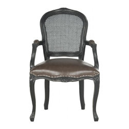 Safavieh - Nala Arm Chair - The French 18th century style of the curvy Safavieh camelback Nala arm chair is updated with a cane backrest and antique brown PU leather upholstery with silver nail head trim. Crafted of ebony-finished oak, the chair features delicate wood carvings. Use this classic beauty in pairs at either end of a dining table, or in the living room on either side of a sofa.