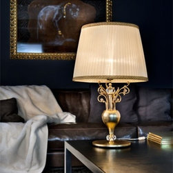 """6015/6016 TL1 Table Light - The 6015/6016 TL1 Table Light is part of a collection of High End light fixtures designed by Studio Stile Masiero in Italy for Masiero. This table lamp is a beautiful and harmonious piece that brings to classicism and modernism a new perspective. 6015/6016 TL1 table lamp is an elegant light fixture available in two sizes consisting of a base and a metal rod enriched with brass fusion decorations in gold-plated finish. A candle-light that sits on the superior side of the rod is covered by a delicate ivory colored Pongè lampshades which is optional. This is a stylish and contemporary table lamp that will light up any environment. Illumination is provided by E27 100W Incandescent bulb (not included).     .proddesc p{font-family: Verdana, sans-serif; font-size:8pt!important;}   .pdtable{font-family: Verdana, sans-serif; font-size:8pt!important;padding:10px;} Product Details: The 6015/6016 TL1 Table Light is part of a collection of High End light fixtures designed by Studio Stile Masiero  in Italy for Masiero. This table lamp is a beautiful and harmonious piece that brings to classicism and modernism a new perspective. 6015/6016 TL1 table lamp is an elegant light fixture   available in two sizes consisting of a base and a  metal rod  enriched with brass fusion decorations in  gold-plated finish. A candle-light that sits on the superior side of the rod is covered by a delicate    ivory colored Pongè lampshades   which is optional.   This is a stylish and contemporary table lamp that will light up any environment. Illumination  is provided by  E27 100W Incandescent    bulb (not included). Details:                         Manufacturer:            Masiero                            Designer:            Studio Stile Masiero                            Made in:            Italy                            Dimensions:                        Small: P: Height: 12.6""""(32cm) X Diameter: 6.3""""(16cm)             Large: G: Height: 25.6""""(65cm) X Diameter: 15.7""""("""