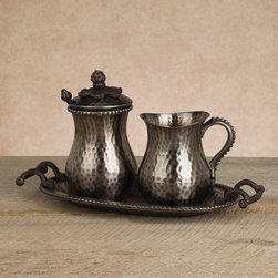 The GG Collection Antique Silver Cream & Sugar Set - All the hallmarks are present – rim beading, rolled and scrolled handles and the ever present lid ornamentation. This new for fall set is bathed in antique silver and includes the creamer, sugar bowl and serving tray.